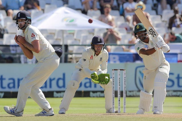 South Africa's Vernon Philander plays a shot while England's wicketkeeper Jos Buttler looks on