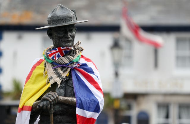 A Dorset flag and a Union flag on the statue (Andrew Matthews/PA)