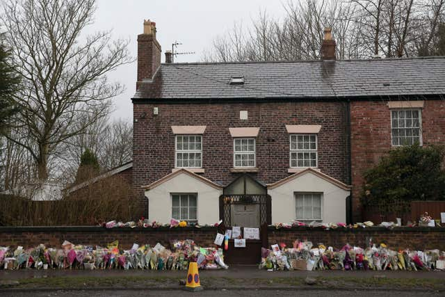 Floral tributes outside the comedian's home (Aaron Chown/PA)