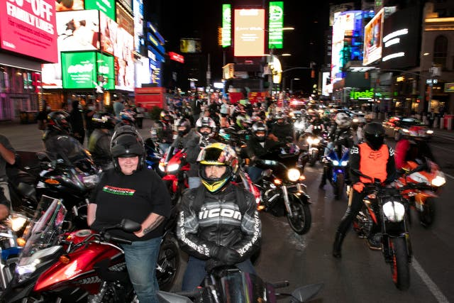 Dozens of motorcyclists stop for photos in New York's Times Square during the coronavirus pandemic