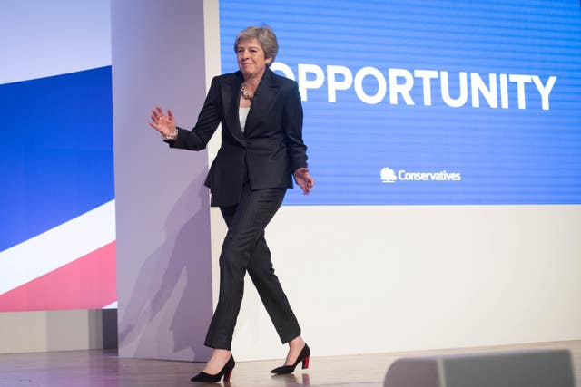 Prime Minister Theresa May dances as she arrives on stage to make her keynote speech at the Conservative Party annual conference