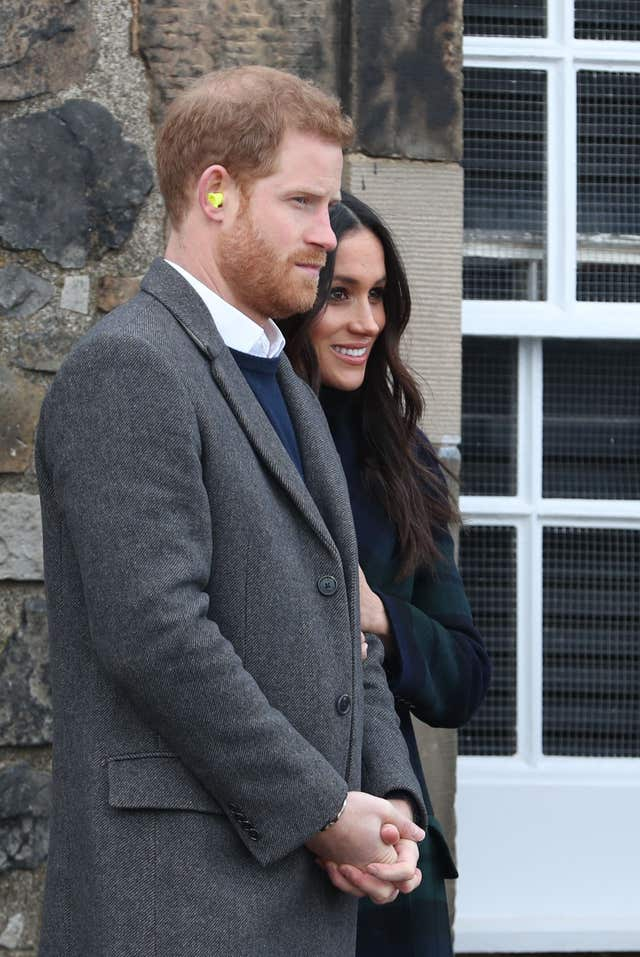 Prince Harry and Meghan Markle watching the firing of the One O'Clock Gun at Edinburgh Castle (Jane Barlow/PA)