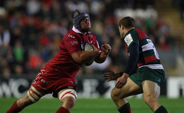 Leicester's Jonah Holmes, right, tackles Scarlets' Will Boyde