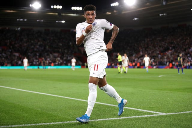 Jadon Sancho celebrates scoring for England against Kosovo