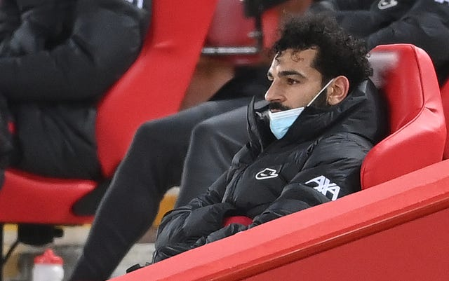 Liverpool forward Mohamed Salah looks dejected as he sits in the stands having been substituted
