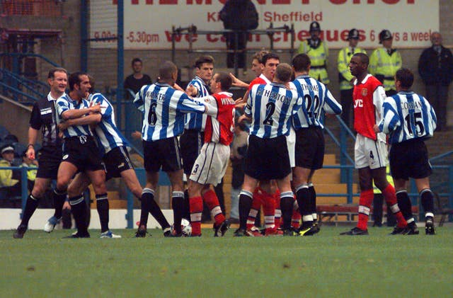 Paolo Di Canio, far left, had to be restained after an incident with Martin Keown, which saw both players dismissed