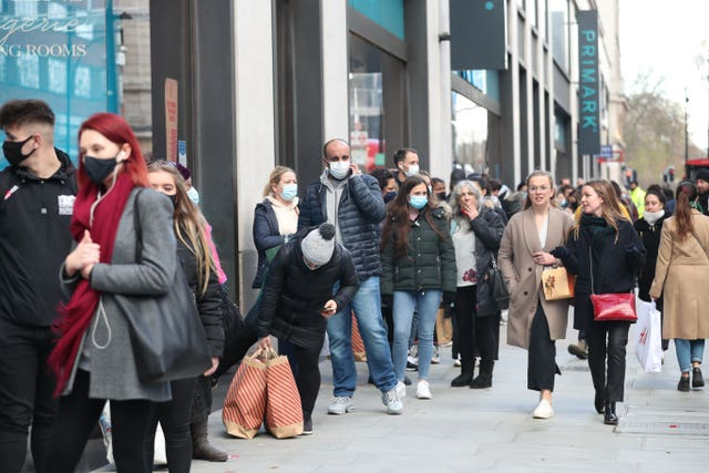 Shoppers queueing in Oxford Street, London