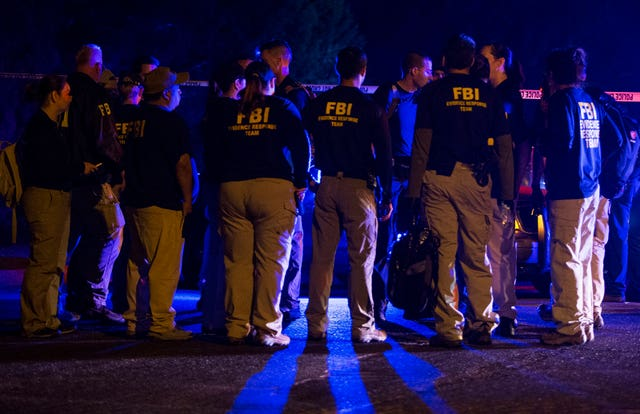 FBI agents meet at the scene of an explosion in Austin, Texas on Sunday (Nick Wagner/AP)