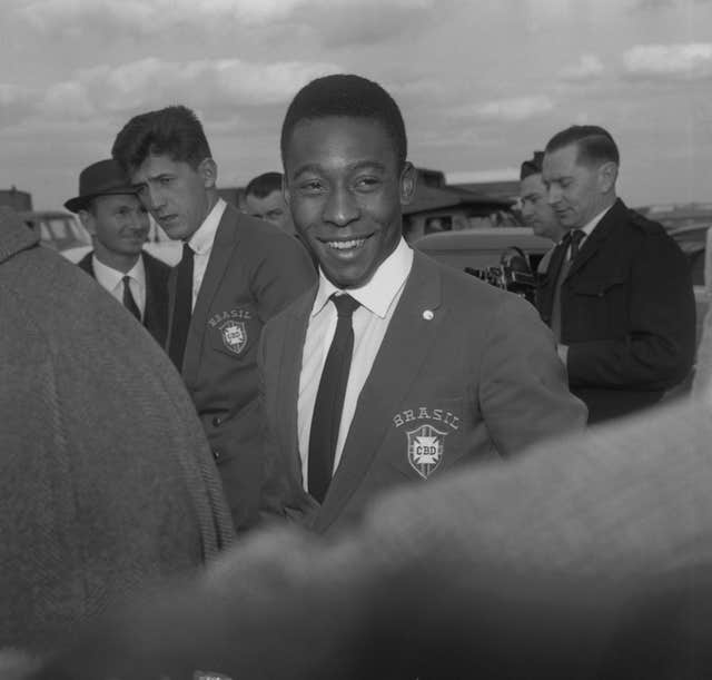 Pele on his arrival at London Airport from West Germany. He travelled with the Brazilian team for a friendly match against England at Wembley Stadium