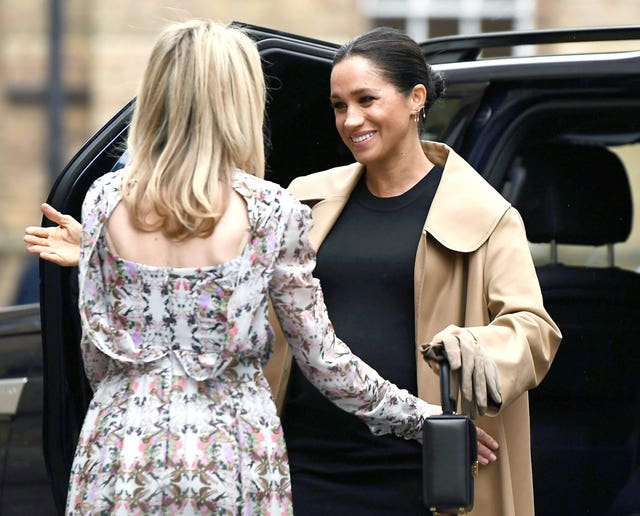Kate Stephens, CEO of Smart Works, welcomes the Duchess of Sussex (right) as she arrives for her visit (Clodagh Kilcoyne/PA)