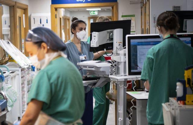 Staff nurses work in the corridor in the Acute Dependency Unit