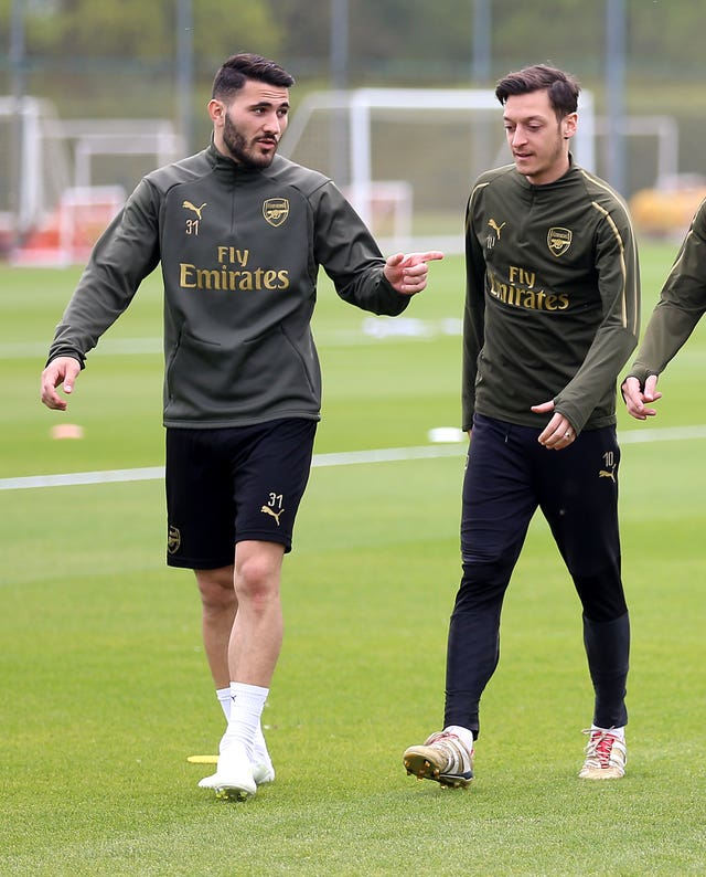Arsenal's Sead Kolasinac (left) and Mesut Ozil, who could return to action after a knife attack forced them to miss the opening weekend of the Premier League