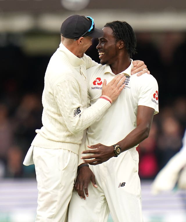 Joe Root and Jofra Archer celebrate the wicket of Australia's Usman Khawaja