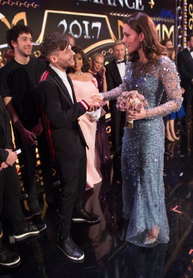 The Duchess of Cambridge meets Louis Tomlinson on stage at the Royal Variety Performance at the London Palladium in central London (Eddie Mulholland/Daily Telegraph/PA)