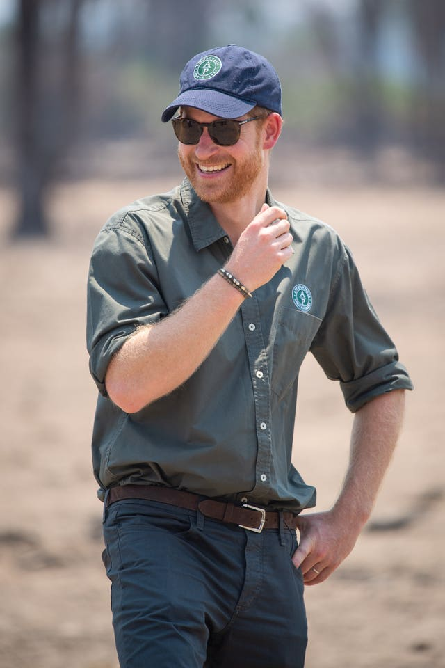 The Duke of Sussex watches an anti-poaching demonstration exercise conducted jointly by local rangers and UK military, at Liwonde National Park, Malawi