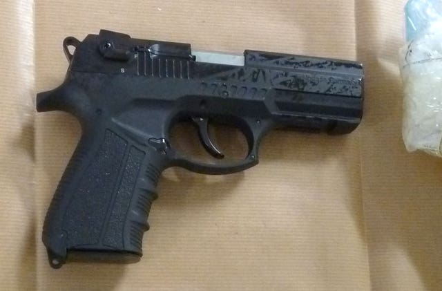 One of the firearms discovered after the car was searched