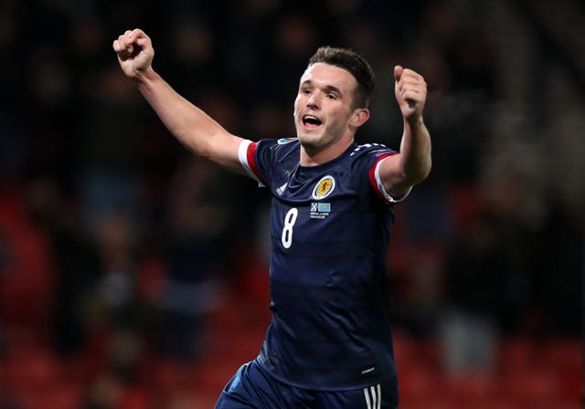 John McGinn celebrate wrapping up victory for Scotland with his second goal of the match