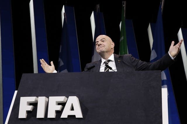Gianni Infantino gestures to the audience at the FIFA congress in Paris