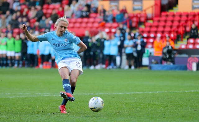 Manchester City's Claire Emslie scores during the penalty shoot out