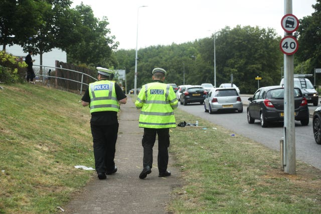 Police at the scene of a crash involving two cars on Monkswood Way in Stevenage