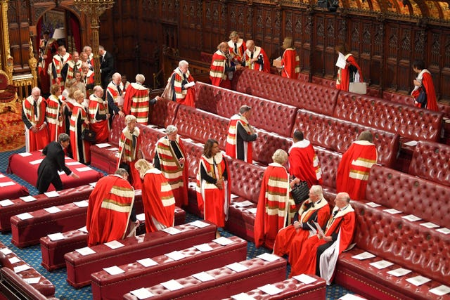 Members of the House of Lords arrive to sit in their seats in the Chamber East Gallery