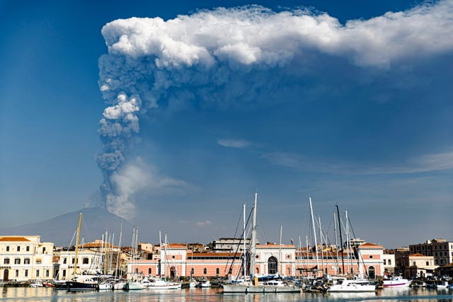 Smoke billows from a crater of Mount Etna