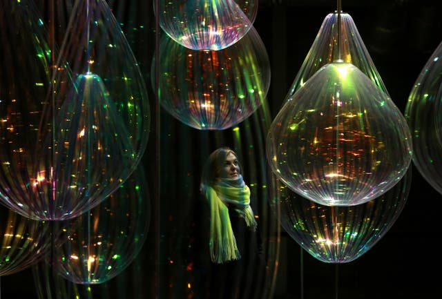Pippa Dale from London interacts with Reflecting Holons by Michiel Martens & Jetske Visser (Matt Alexander/PA)