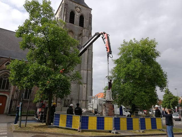 Handout photo issued by Ilse de Schutter showing a statue of Belgian king Leopold II being removed by local authorities in Antwerp (Ilse de Schutter/PA)