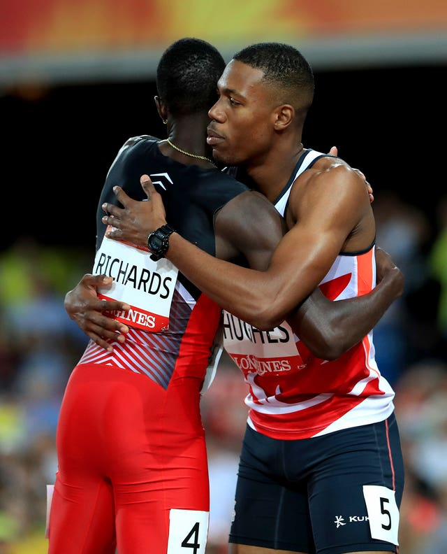 Trinidad and Tobago's Jereem Richards (left) congratulates England's Zharnel Hughes for winning the men's 200 metres, before either of them learned that Hughes had been disqualfied for obstruction