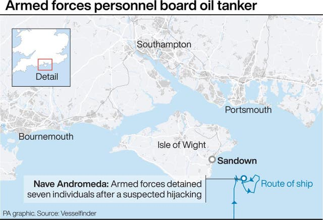 Armed forces personnel board oil tanker