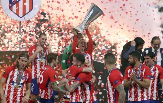 Former Atletico Madrid forward Antoine Griezmann (centre) celebrates