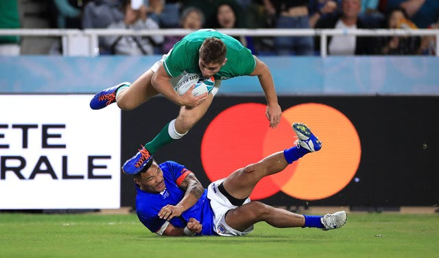 Ireland's Jordan Larmour (top) scores a try against Samoa