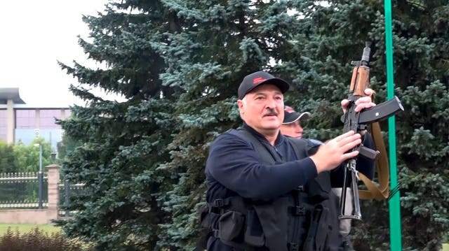 Alexander Lukashenko armed with a rifle