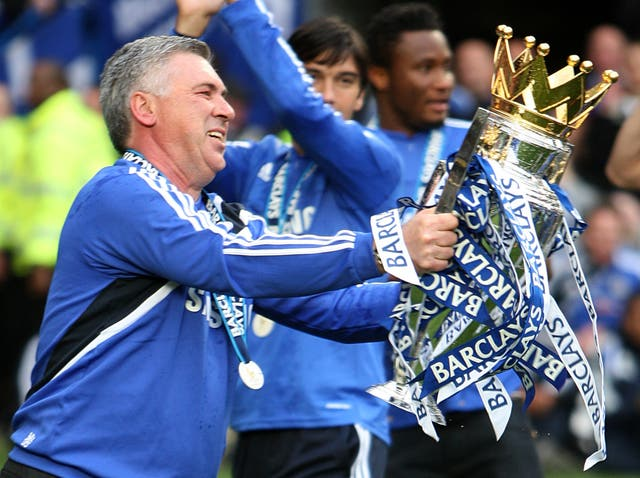 Carlo Ancelotti lifts the Premier League trophy