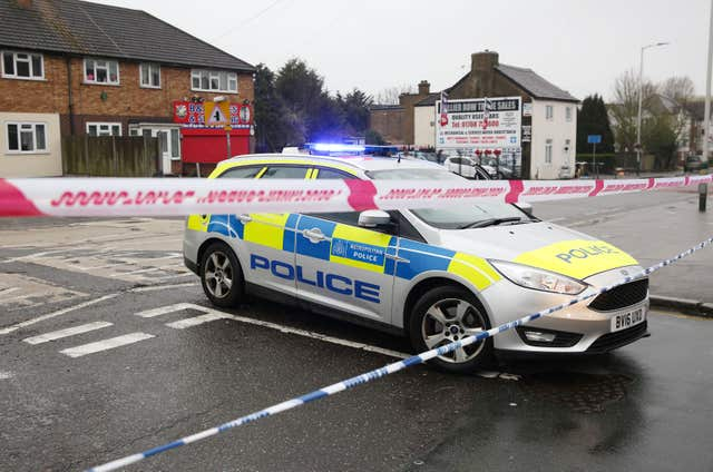 Police at the scene in Collier Row Road (Isabel Infantes/PA)