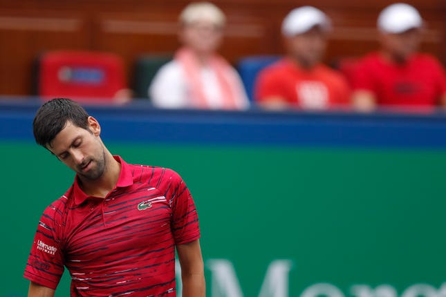 Novak Djokovic looks downcast during his defeat by Stefanos Tsitsipas
