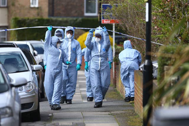 Forensic officers at the scene in South Park Crescent in Hither Green, London (Gareth Fuller/PA)