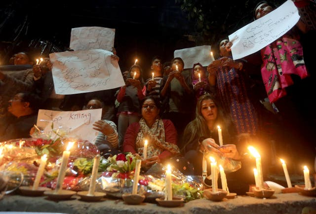 Members of civil society group 'Joint Action Committee for People Rights' hold a candle light vigil for the victims of Christchurch mosque shooting, in Lahore, Pakistan