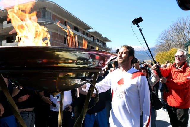 Gerard Butler was a torchbearer for the Olympic flame