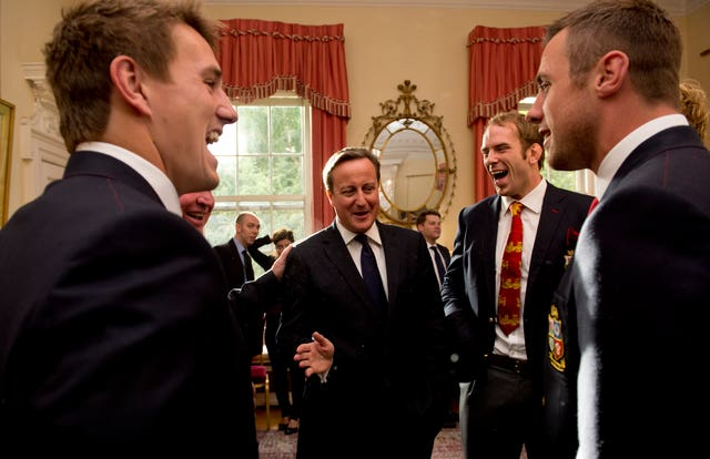 Alun Wyn Jones, centre right, and his team meet Prime Minister David Cameron after the Lions' victorious 2013 tour