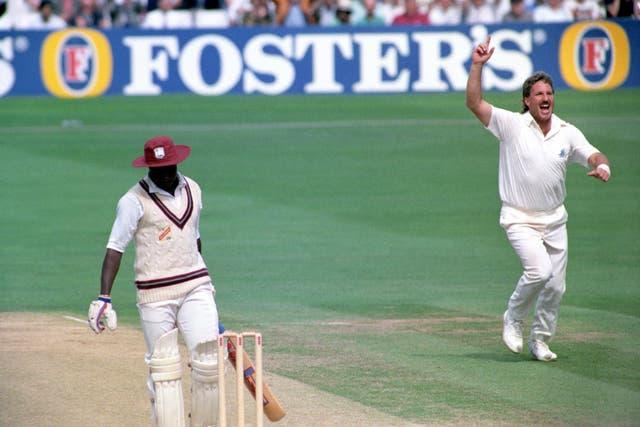 Ian Botham celebrates one of his 383 Test wickets