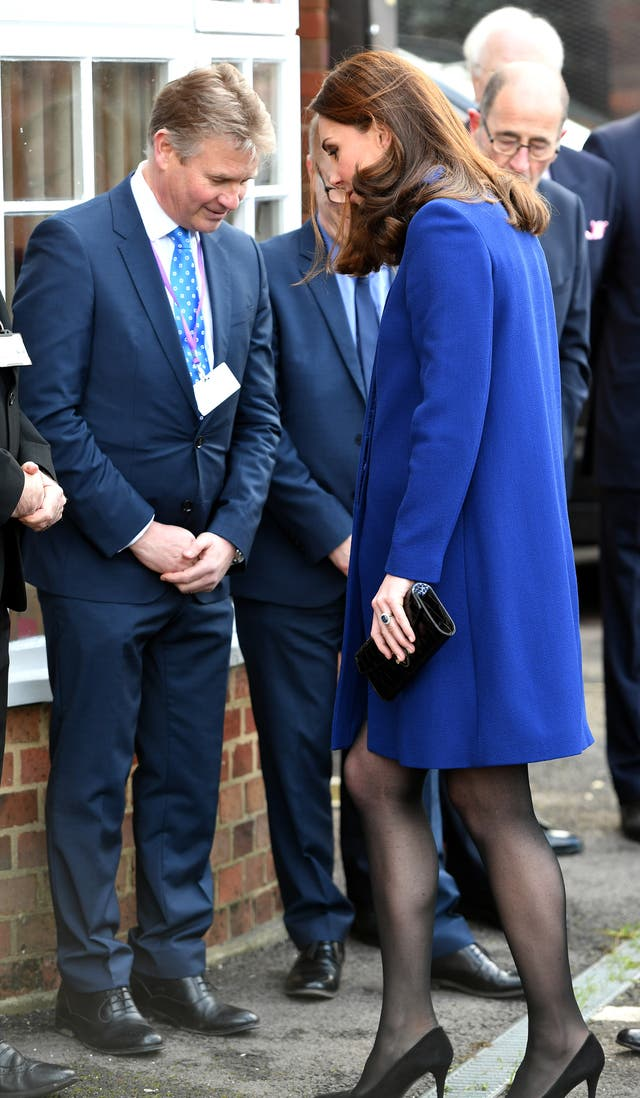 The Duchess of Cambridge, gets her heel caught in a drainage grate as she arrives to open the addiction treatment centre (John Stillwell/PA)