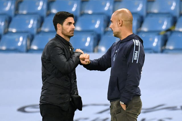 Arsenal manager Mikel Arteta greets Manchester City boss Pep Guardiola