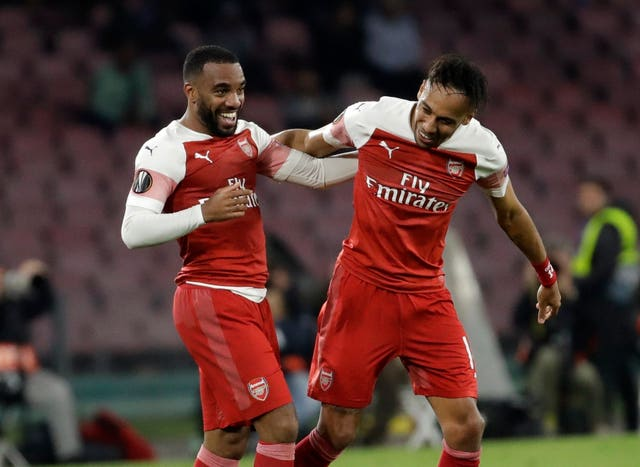 Alexandre Lacazette, left, celebrates his goal against Napoli with Pierre-Emerick Aubameyang