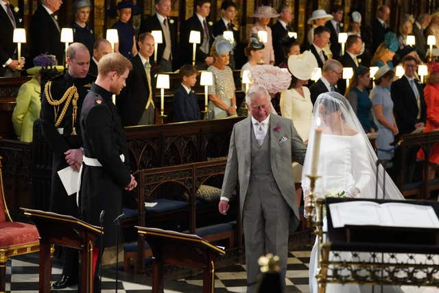 Meghan is accompanied to the altar by the Prince of Wales after her father Thomas Markle pulled out of attending her wedding