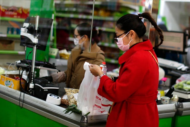 Customers wear face masks in a supermarket in Madrid, Spain