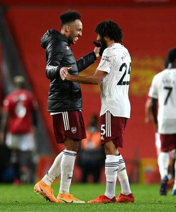 Mohamed Elneny celebrates with match-winner Pierre-Emerick Aubameyang (left) at Old Trafford