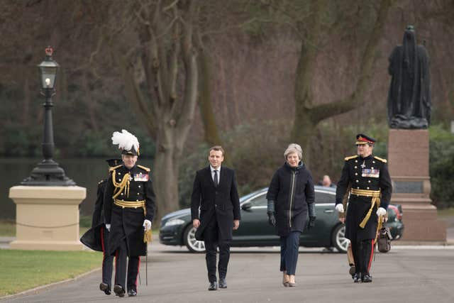 Theresa May and Emmanuel Macron at the UK-France summit at Sandhurst (Stefan Roussea/PA)