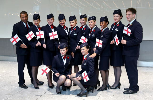 British Airways staff wait with England flags
