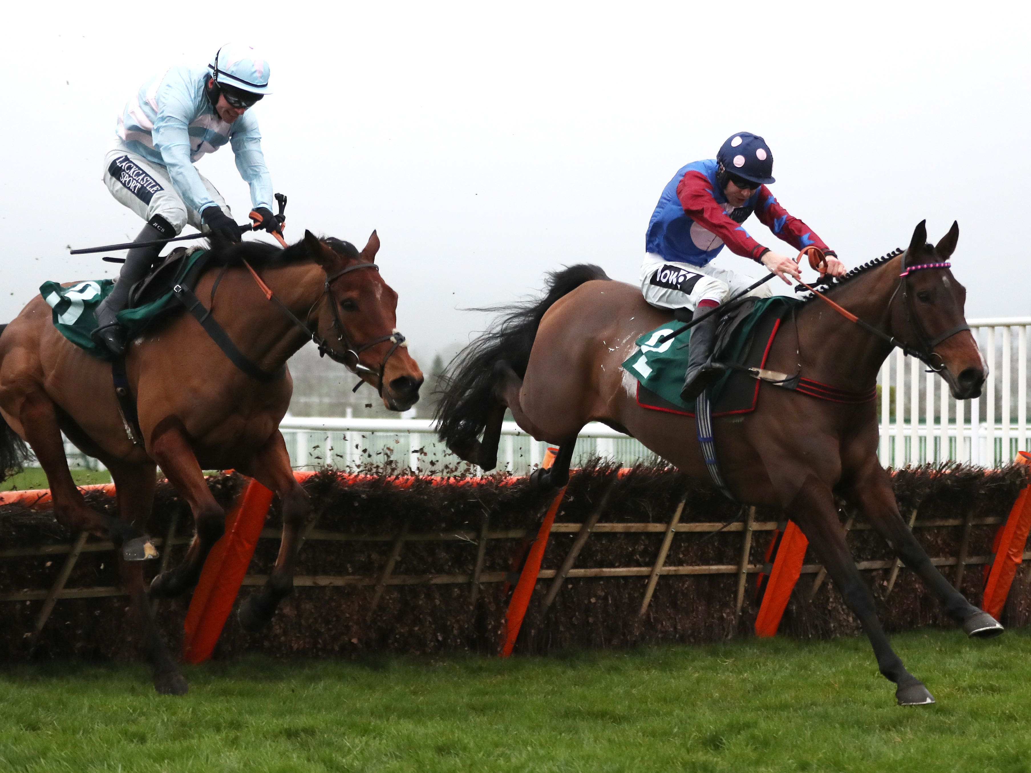 Paisley Park and Summerville Boy battle it out in the Cleeve Hurdle (David Davies/PA)